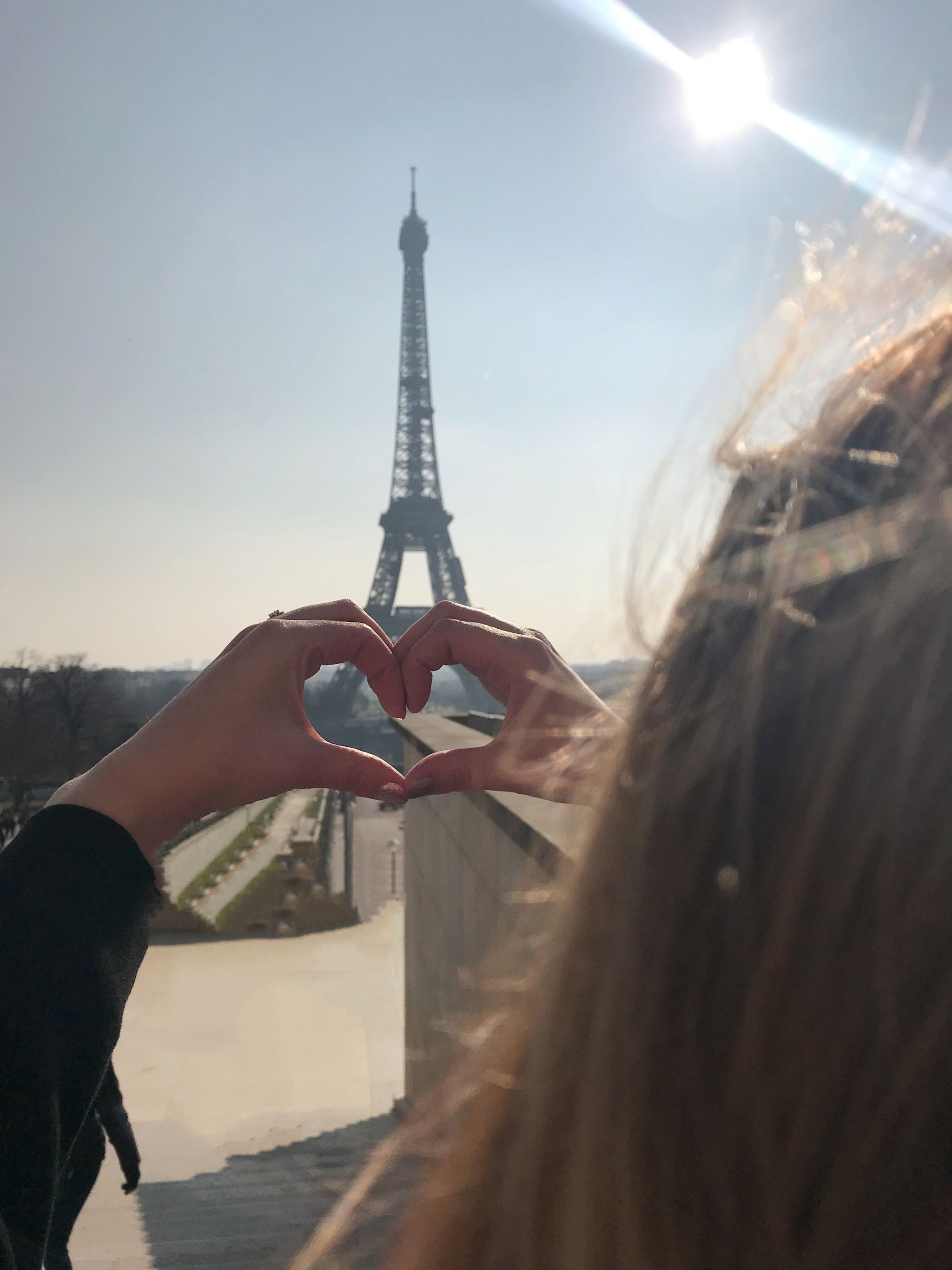 From Paris with love making heart shapes at the Eiffel Tower