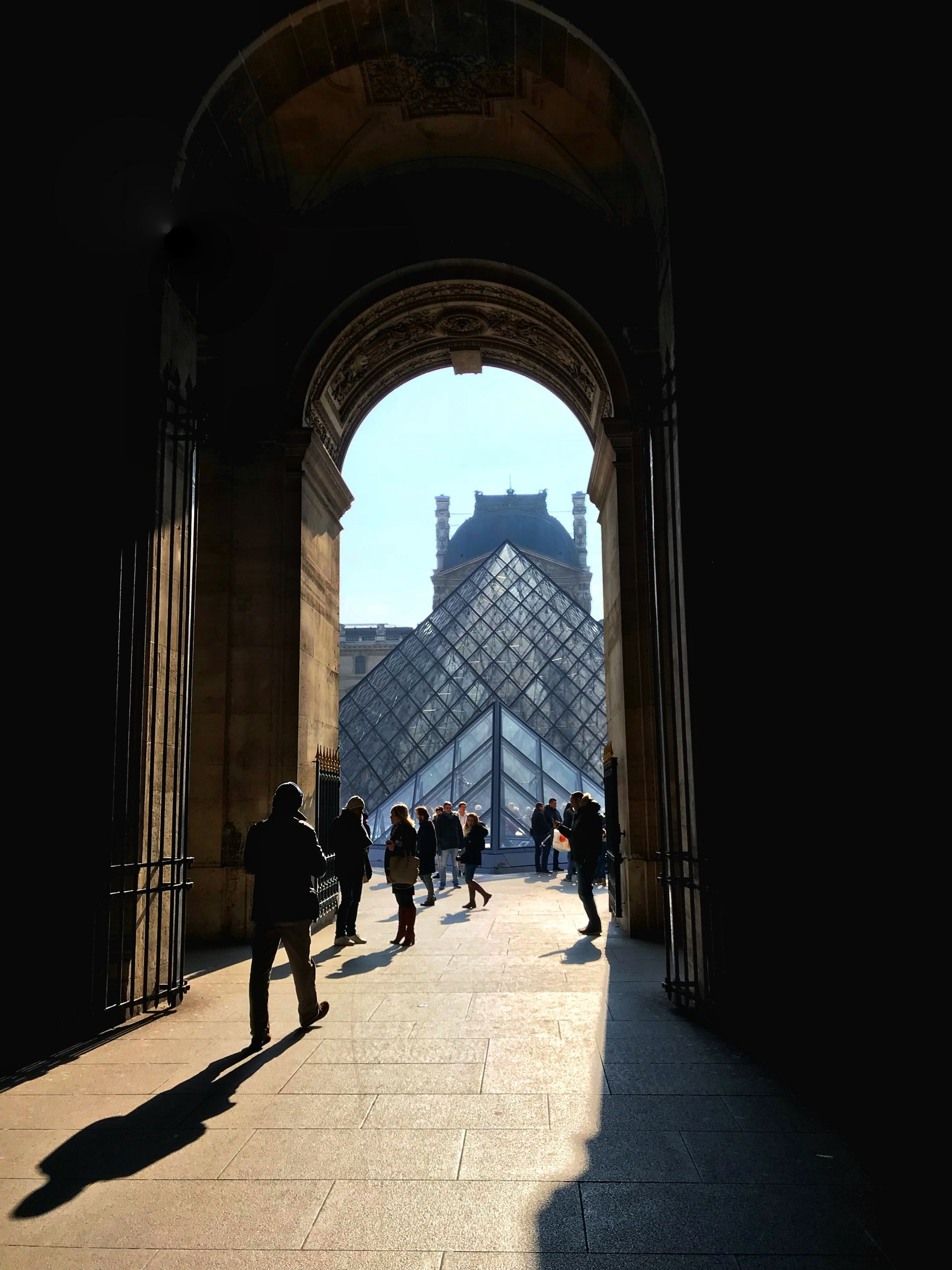 Shadows in the archway to The Louvre Paris