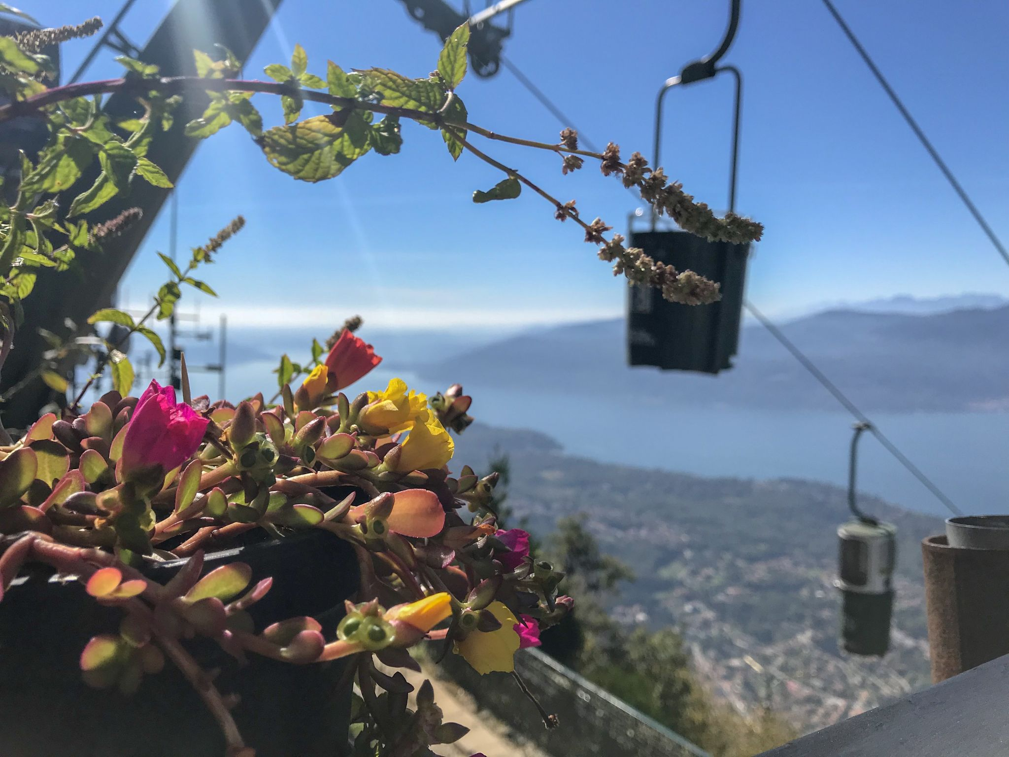 Open and closed topped bucket lift cable cars at Lake Maggiore