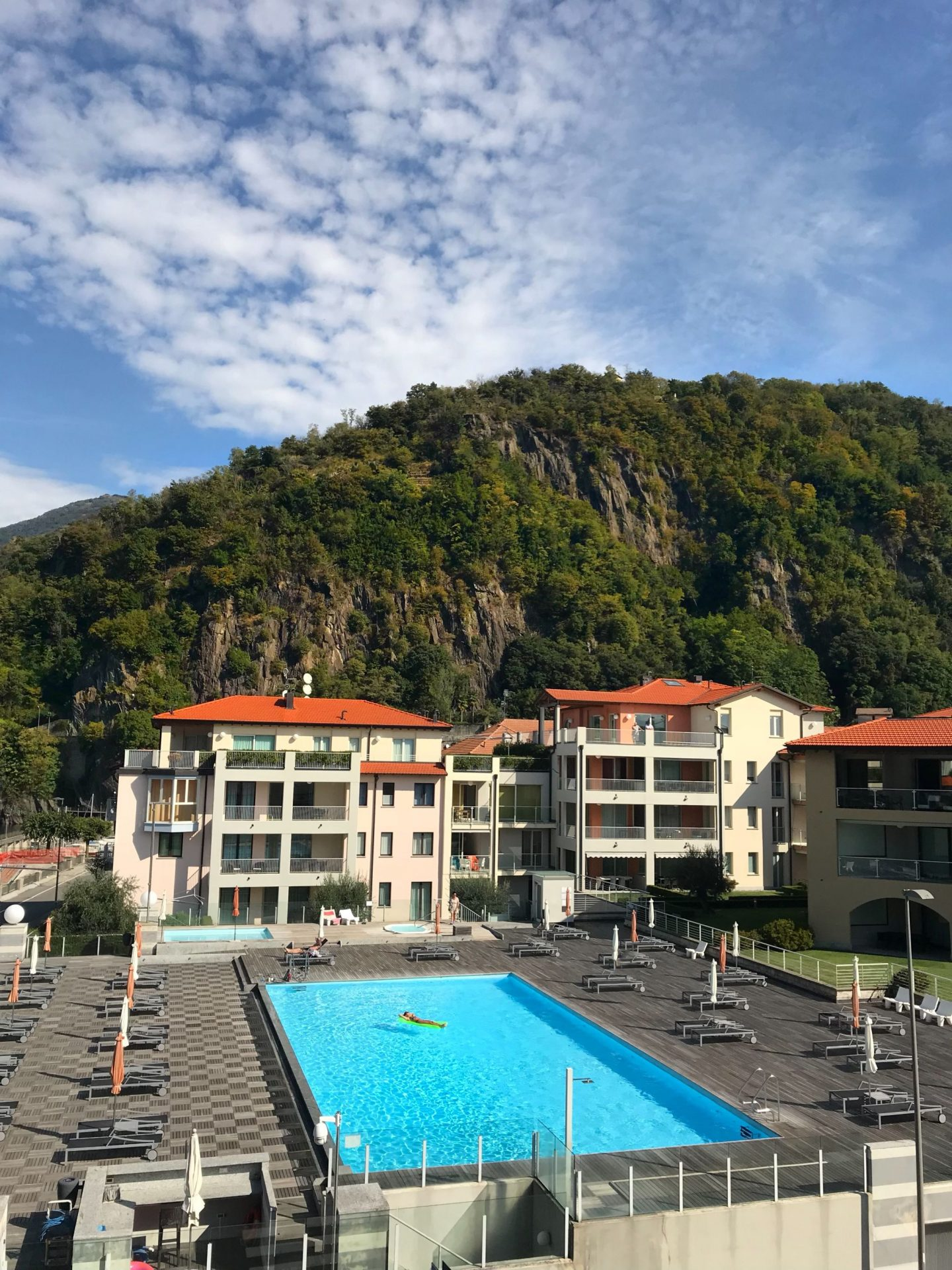 Picturesque pool and mountain views on holiday at Golfo Gabella Resort Lake Maggiore Italy