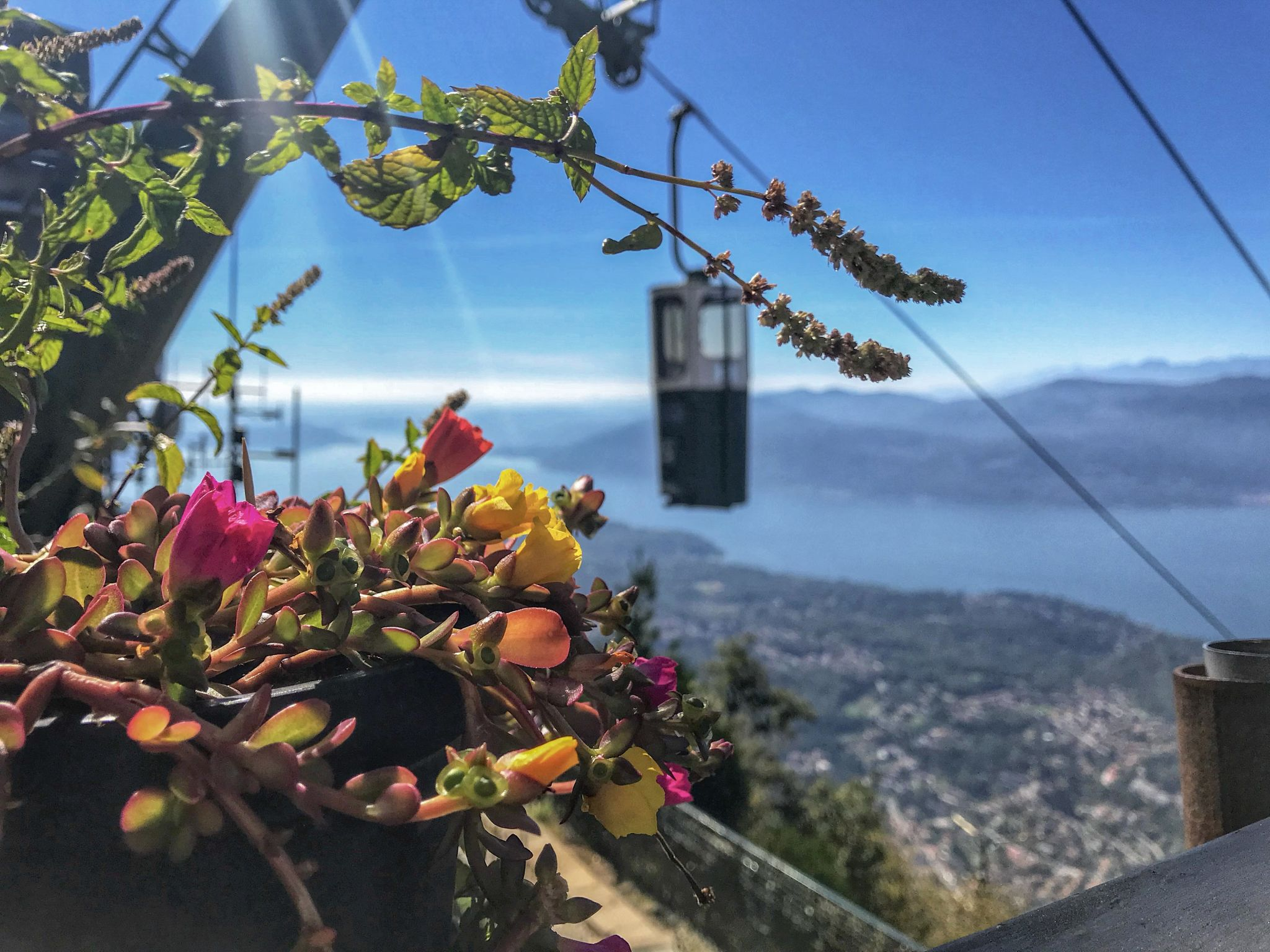Pretty views overlooking the closed-top bucket lift cable car of Lake Maggiore