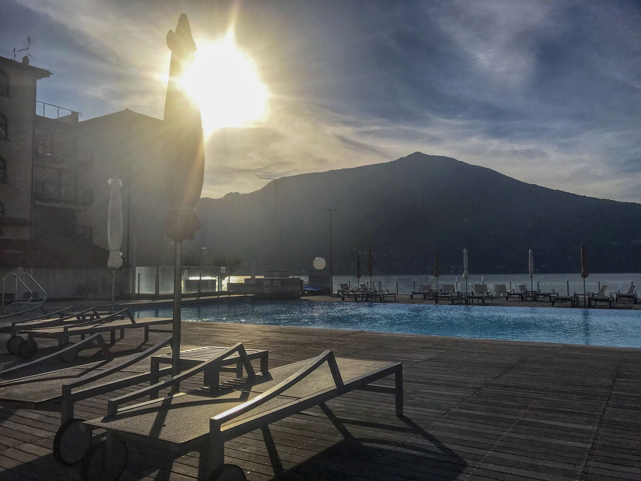 sunset over the pool on holiday at Golfo Gabella Resort Lake Maggiore