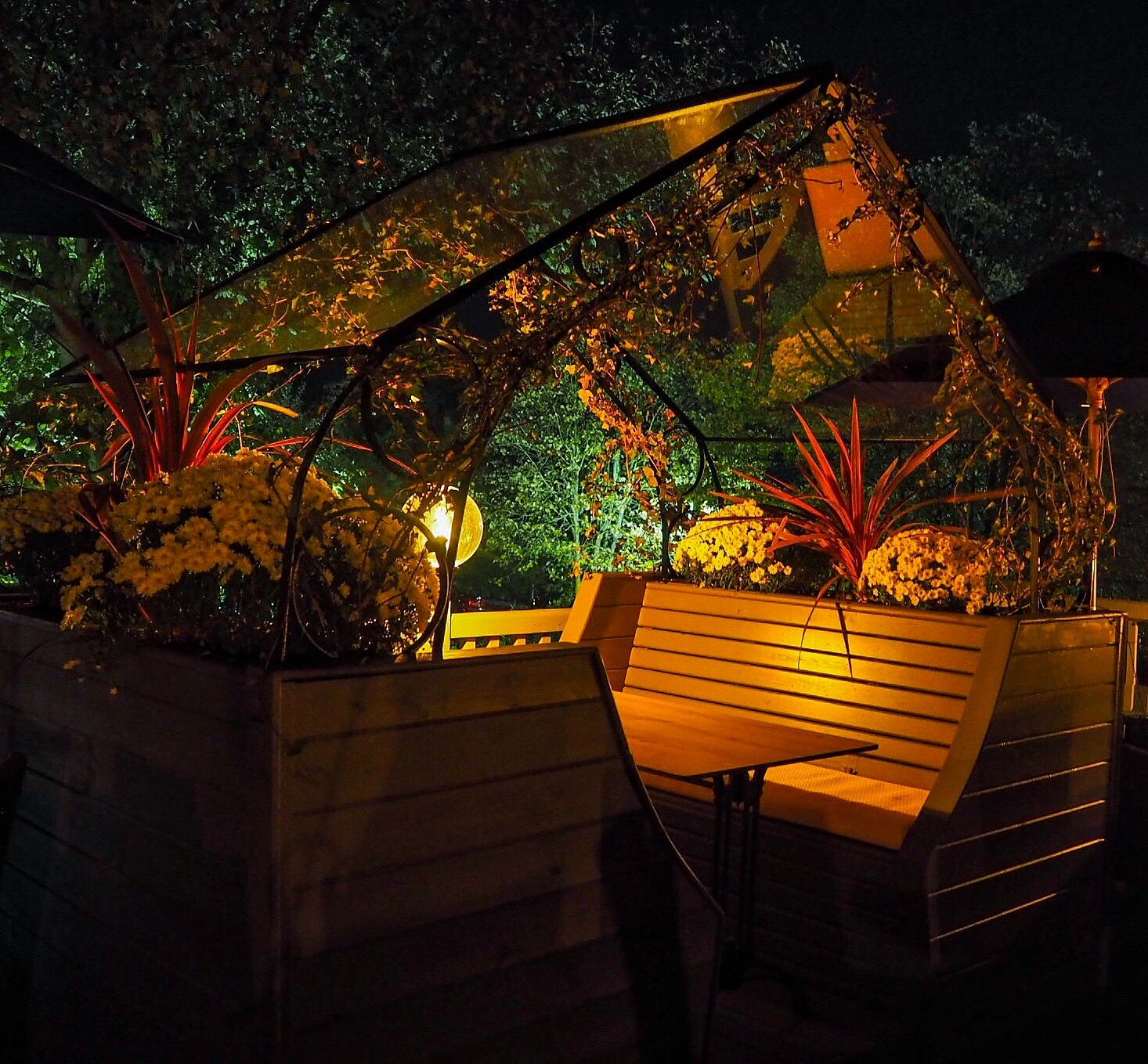 Flowered greenhouse seating pods on the terrace Black Horse Pub Great Linford Milton Keynes