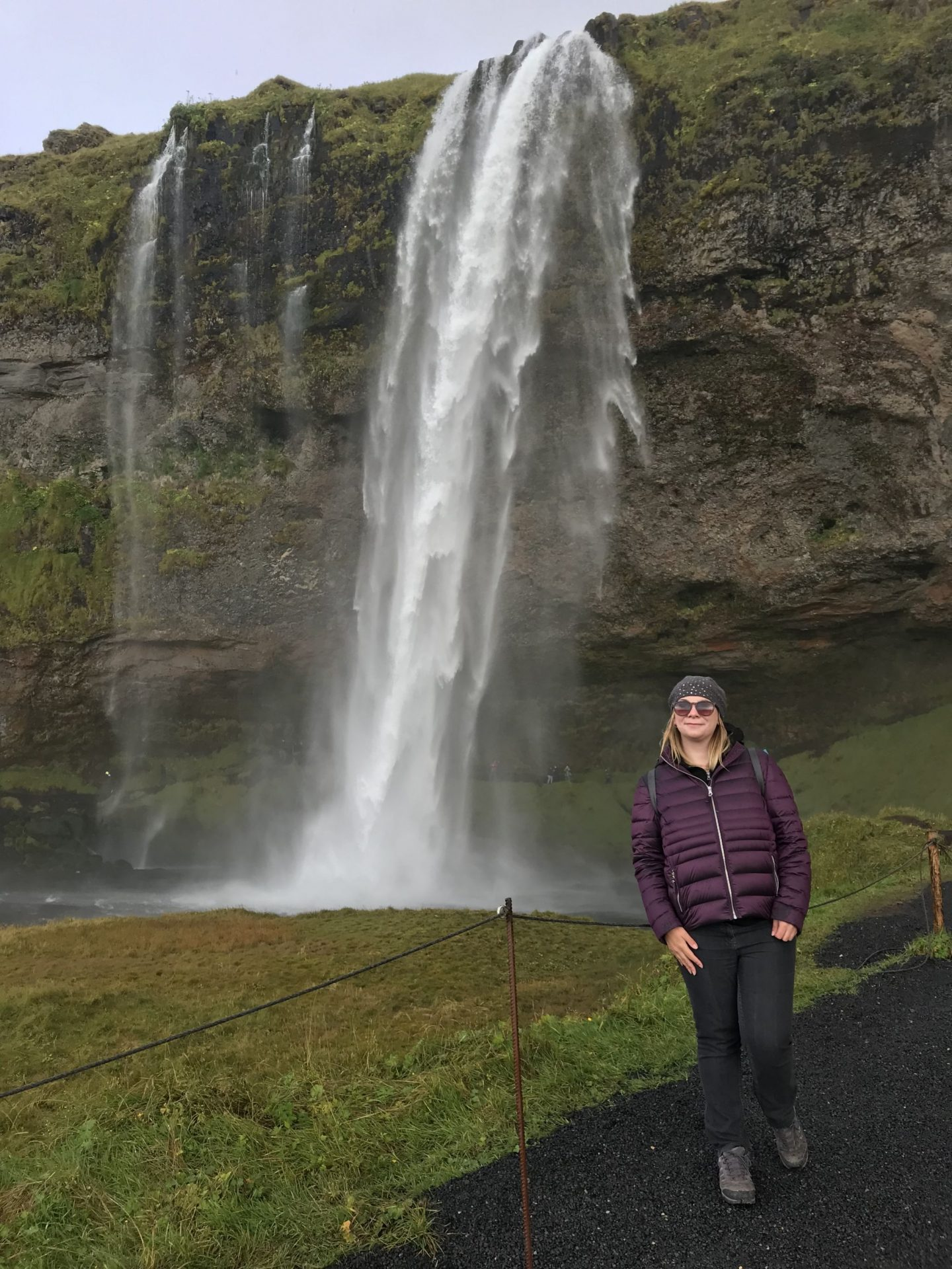 Me next to the magnificent Seljalandsfoss waterfall in Iceland during Autumn