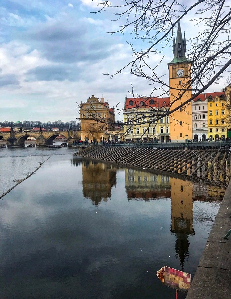 Colourful reflections across the Vltava River Prague