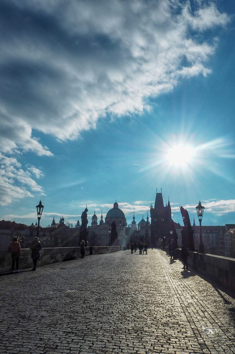 Early morning walk along Charles Bridge Prague